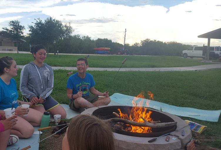 Summer leaderships camps laughing campers eating smores